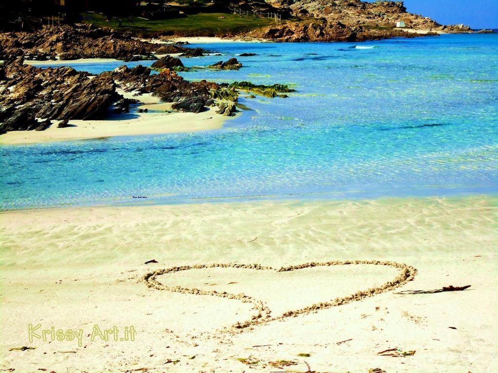 Un cuore sulla sabbia - spiaggia della pelosa a Stintino - Sardegna